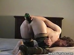 Amateur gay burying bottle in the asshole