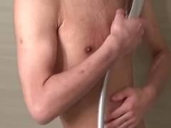 20 year old Japanese twink in the shower with his already hard dick