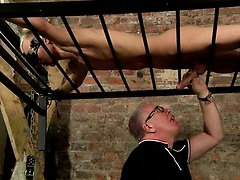 Swinging above, Reece has his big uncut cock totally drained by master Kane!
