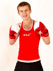 Sporty straight Eugene Small posing in boxing gloves