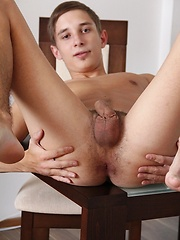 Smooth chested Kevin Ateah plays with his smaller cock.