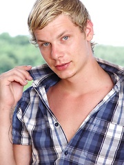 Blond stud Damion Diesel stroking his hard cock.