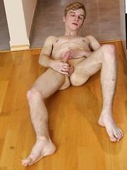 Skinny dude Julian Caro strokes his beautiful cock.